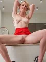 Jaqueline strips out of her red lingerie in Exhibitionist