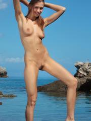 Eufrat gets naked on the beach in Taormina