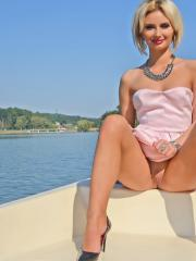 Blonde babe Erika Larson stripping and teasing in lingerie at the lake