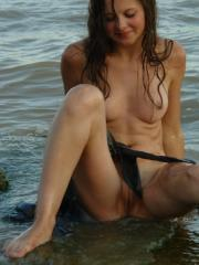 Pretty coed Petra E goes skinny dipping in the ocean