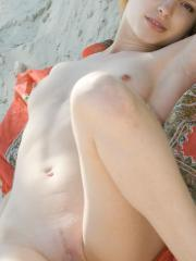 """Blonde babe Kira E gets naked on the beach in """"My Favourite Place"""""""