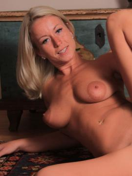 Busty blonde Lexie Heard spreads nude on the floor