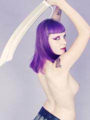 Busty sword-wielding fantasy Barbarian beauty cosplays nude for you