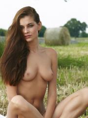 Redhead beauty Indiana A gets completely naked on the farm