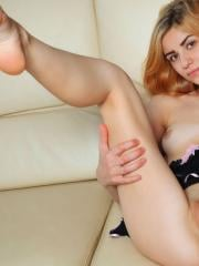 Redhead cutie Abril C dresses up in her sexy lingerie just for you