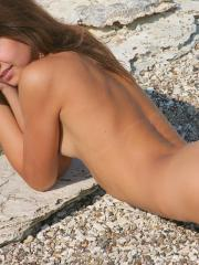 Pictures of Rita B enjoying her nakedness on a beach