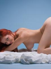 Pictures of redhead hottie Ariel in On Cloud 9