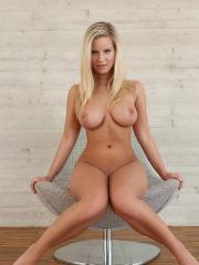 Busty blonde beauty Miela gets totally nude just for you
