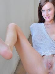 Redhead hottie Jayden slips off her socks and spreads her legs