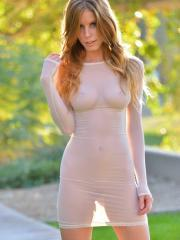 Beautiful blonde girl Bethany teases sensually in seethrough dresses