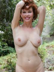 "Busty redhead gets naked for you in ""Love Of Sprinkles"""