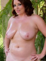 "Busty hottie Maggie Green gets slippery for you in ""Oiling The Girls"""