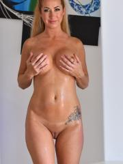 Busty girl Janna gets naked for you in Revealing The Girls