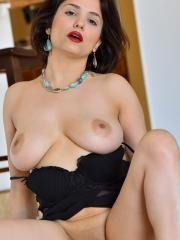 "Busty girl Mitzi gives you her fun parts in ""Oiling The Girls"""