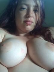 Busty GF takes selfies of her amazing boobs