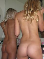 Two hot cheerleaders get naked and take pics