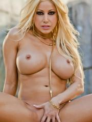 Gina Lynn struts and plays poolside