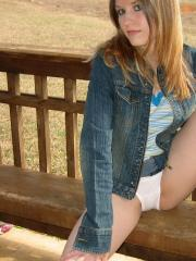 Cute teen Shelby flashes her nipples and panties at the lake in a public park