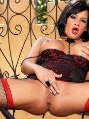 Busty hottie Tory Lane shows off her pussy in black and red lingerie