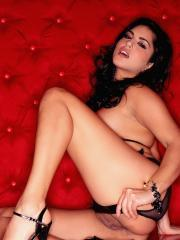 Pictures of Sunny Leone pulling back her black lingerie to give you her wet pussy
