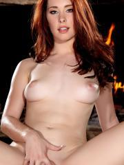 Pictures of redhead stunner Melody Jordan spreading her pink pussy for you