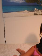 Brunette teen Katie waits in bed for you