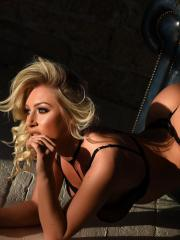 Stacey strips out of her black see through lingerie on the chair