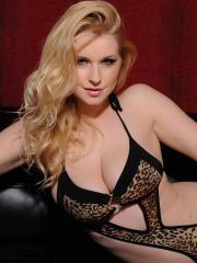 Blonde beauty Jess Davies shows off long legs and round boobs in black lingerie