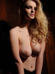 Stunning blonde babe Jess Davies shows you her round natural boobs