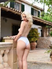 Blonde babe Jess Davies strips in her high heels outside
