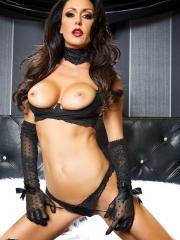 Hot babe Jessica Jaymes puts on some kinky lingerie and fingers her wet pussy