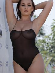 Jodie Gasson pulls down her black one-piece to reveal her incredible boobs