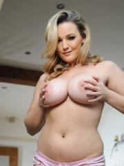 Busty blonde Jodie Gasson gives you a sexy striptease in the living room