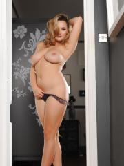 Busty blonde Jodie Gasson strips off her dress to reveal her big natural boobs