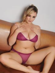 Busty babe Jodie Gasson exposes her big boobs on the couch