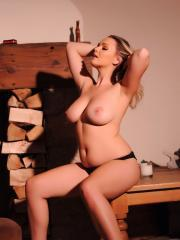 Jodie Gasson shows you her big natural boobs next to the wood burning stove