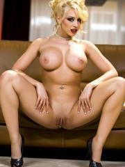 Pictures of Kagney Linn Karter playing with her pussy on the couch