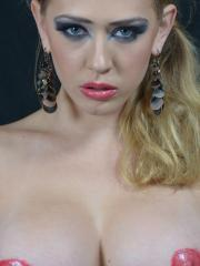 Pictures of Kagney Linn Karter getting carried away with her makeup