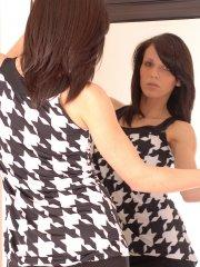 Pictures of Karen Dreams checking herself out in the mirror