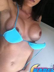 Karen Dreams takes pics of her boobs in a blue bikini