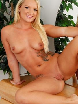 Tattooed blonde Cali Carter toys her tight wet pussy