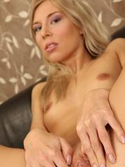 Tall blond Adriana fingering her shaved pussy