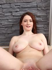 Busty redhead Maria Beaumont spreading her pussy