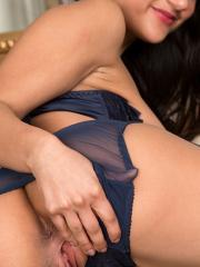 Stunning babe Estelle slowly strips off her sexy blue lingerie