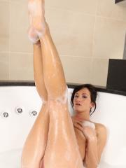 Tess gets all soapy as she masturbates in the bath