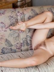 Natural coed Denisa exposes her hairy pussy