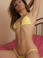Stephanie slowly strips out of her very skimpy yellow bikini