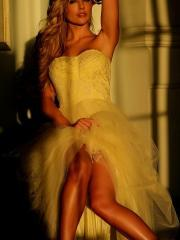 Blonde babe Kayden Kross teases in a white lace dress