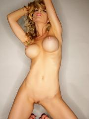 Busty hottie Kayden Kross strips naked and flaunts her tight body