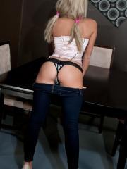 Blonde babe Kendra Rain teases in a corset and pigtails